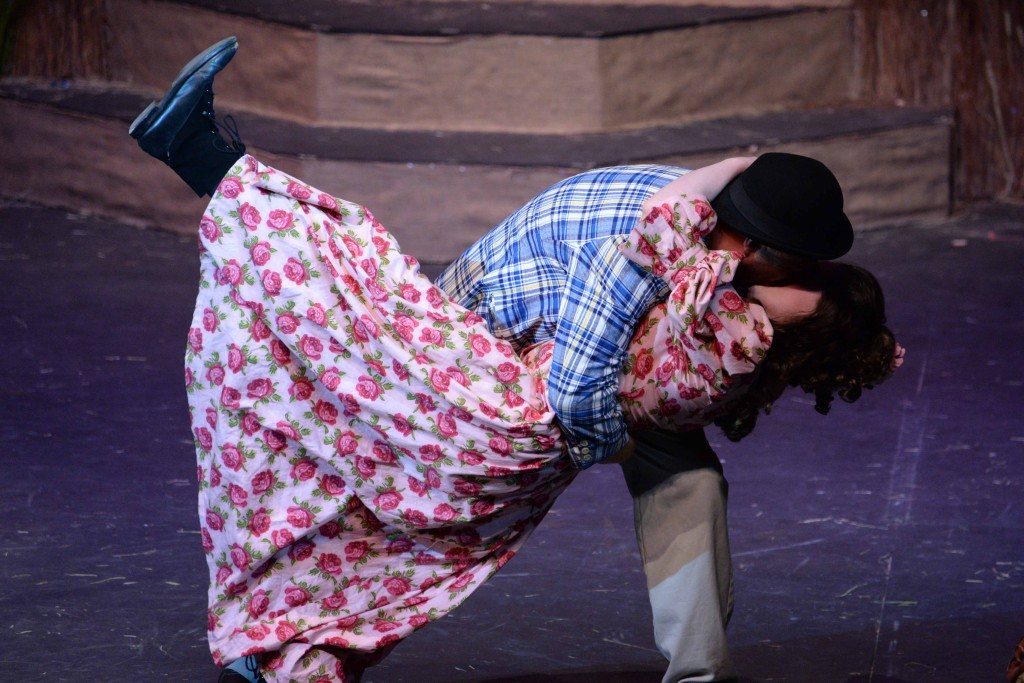 Rob Sprankle as Ali Hakim, in a clinch with Sirena Dib as Ado Annie; photo by Matthew Mills